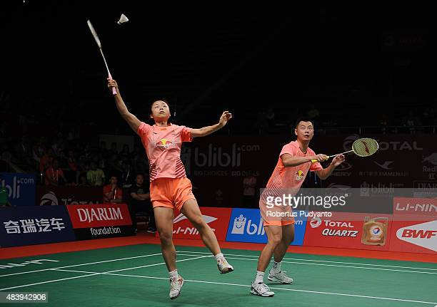 Xu Chen and Ma Jin of China compete against Jacco Arends and Selena Piek of Netherlands in the quarter finals match of the 2015 Total BWF World...