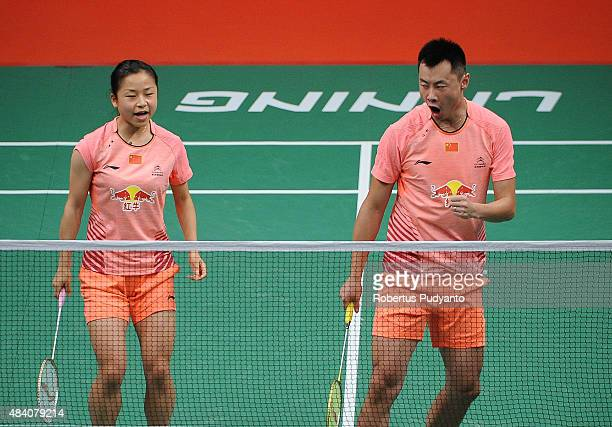 Xu Chen and Ma Jin of China compete against Liu Cheng and Bao Yixin of China in the semi final match of the 2015 Total BWF World Championship at...