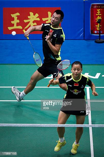 Xu Chen and Ma Jin of China in action during their mixed doubles quarterfinal match against Robert Mateusiak and Nadiezda Zieba of Poland at the 2013...