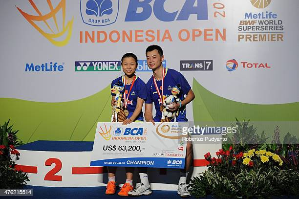 Xu Chen and Ma Jin of China pose on the podium after winning Mixed Double's Final in the 2015 BCA Indonesia Open at Istora Senayan on June 7 2015 in...