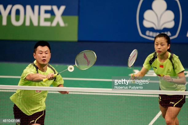 Xu Chen and Ma Jin of China return a shot against Joachim Fischer Nielsen and Christinna Pedersen of Denmark during the Mix Doubles final BCA...