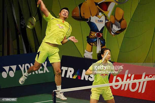 Xu Chen and Ma Jin of China return a shot against Solgyu Choi and Eom Hye Won of Korea during the 2015 BCA Indonesia Open Round 2 match on June 4...