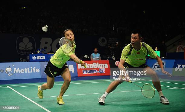 Xu Chen and Ma Jin of China return a shot against Tontowi Ahmad and Liliyana Natsir of Indonesia during the semifinal BCA Indonesia Open 2014 MetLife...