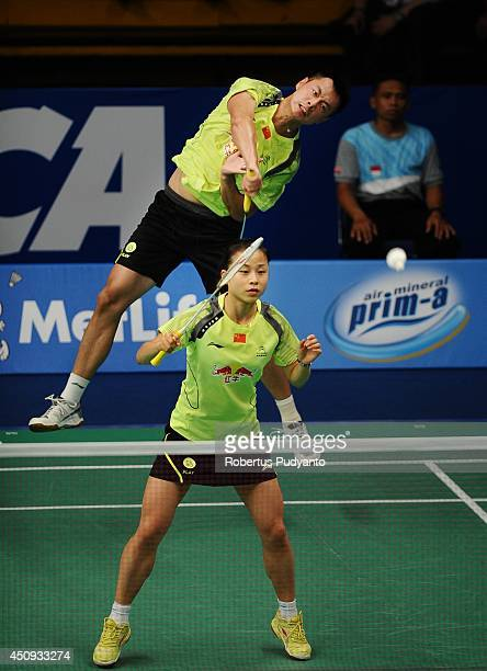 Xu Chen and Ma Jin of China returns a shot against Kai Lu and Yaqiong Huang of China during the BCA Indonesia Open 2014 MetLife BWF World Super...