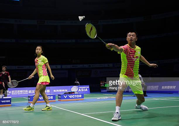 Xu Chen of china hits a return next to him partner Ma Jin during their mixed doubles match against Artur Niyazov and Veronica sorokina of Kazakhstan...