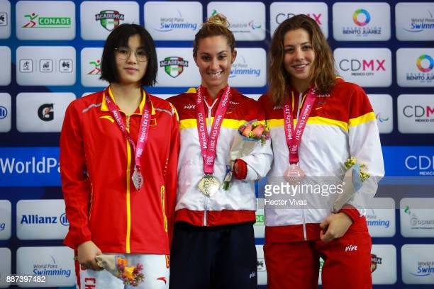 Xu Jialing of China Sarai Gascon of Spain and Nuria Marques of Spain pose after the Women's 100m Butterfly S9 Final during day 5 of the Para Swimming...