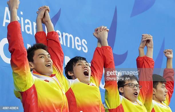 Xu Jiayu Li Xiang Li Zhauhao and Ning Zetao of China celebrate after winning the Men's 4 X 100m Medley during the 2014 Asian Games at Munhak Park...