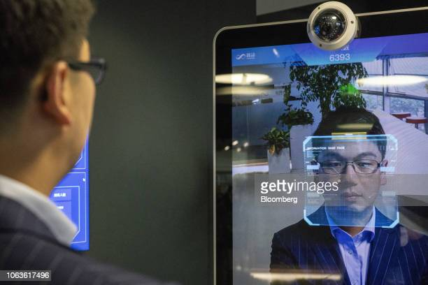 Xu Li chief executive officer of SenseTime Group Ltd is identified by the company's facial recognitionsystem on a screen as he poses for a...