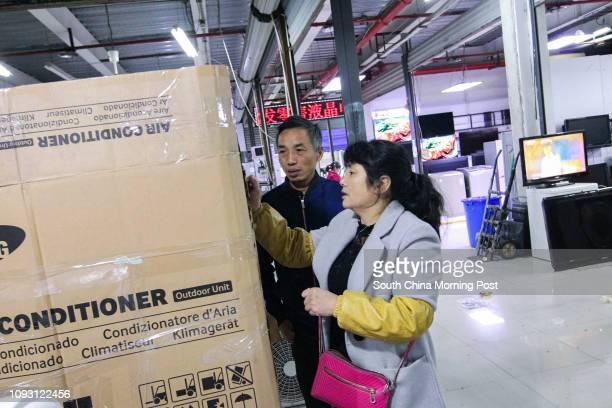 Xu Lida and his wife Qian Fengxiang run a secondhand electrical appliances shop in Hangzhou city Zhejiang province on Nov 20 2017 Xu Lida's wife Qian...