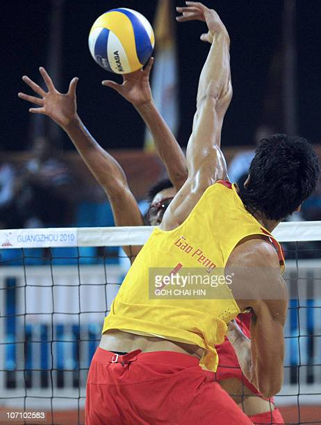 Xu Linyin of China blocks shot from compatriot Gao Peng during the beach volleyball men's final match at the 16th Asian Games in Guangzhou on...