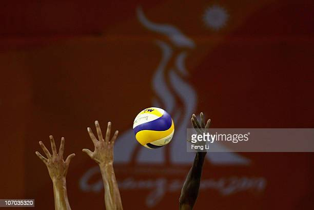 Xu Linyin of China competes the ball with Ahmed Al Housni of Oman in Men's Round of 16 match at Beach Volleyball Venue during day eight of the 16th...