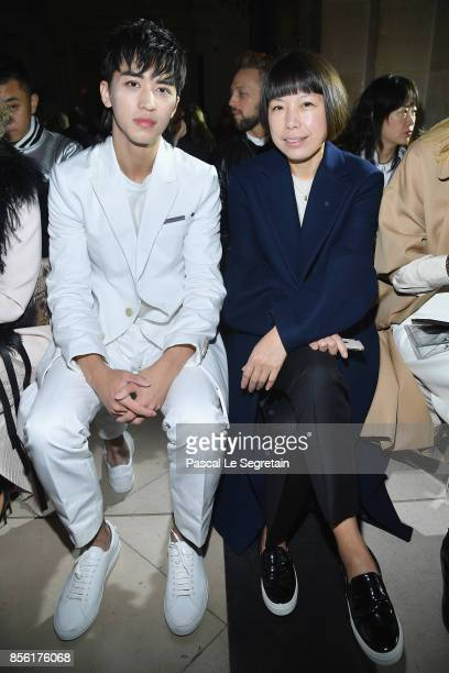 Xu Weizhou and Angelica Cheung attend the Givenchy show as part of the Paris Fashion Week Womenswear Spring/Summer 2018 on October 1 2017 in Paris...