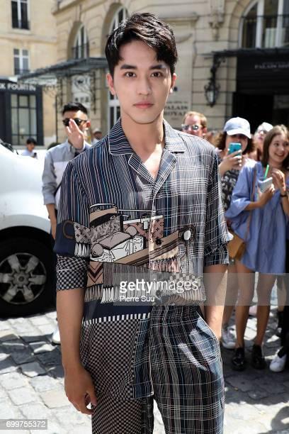 Xu Weizhou arrives at the Louis Vuitton show during the Paris Fashion Week Menswear Spring/Summer 2018 on June 22 2017 in Paris France