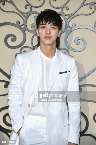 Xu Weizhou attends the Givenchy show as part of the Paris Fashion Week Womenswear Spring/Summer 2018 on October 1 2017 in Paris France