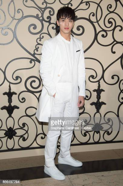 Xu Weizhou attends the Givenchy show as part of the Paris Fashion Week Womenswear Spring/Summer 2018 at on October 1 2017 in Paris France