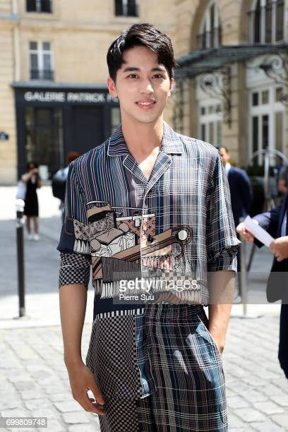 Xu Weizhou attends the Louis Vuitton Menswear Spring/Summer 2018 show as part of Paris Fashion Week on June 22 2017 in Paris France