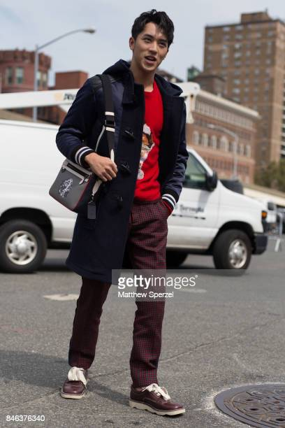 Xu Weizhou is seen attending Coach during New York Fashion Week wearing a navy coat on September 12 2017 in New York City