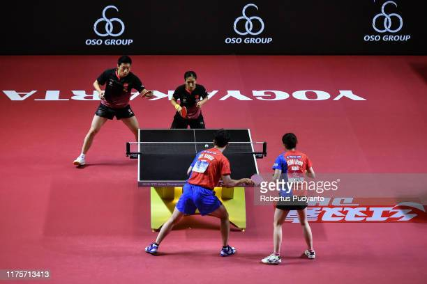 Xu Xin and Liu Shiwen of China compete against Lee Sangsu and Jeon Jihee of South Korea during Mixed Doubles semi-final match on day five of the...