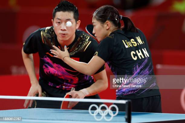 Xu Xin and Liu Shiwen of China compete in the Mixed Doubles Gold Medal Match against Jun Mizutani and Mima Ito of Japan on day three of the Tokyo...