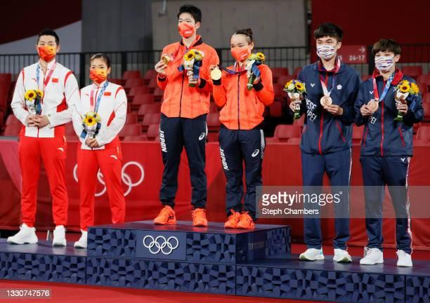 Xu Xin and Liu Shiwen of Team China, Ito Mima and Jun Mizutani of Team Japan, and Lin Yun Ju and Cheng I Ching of Team Chinese Taipei, pose for...