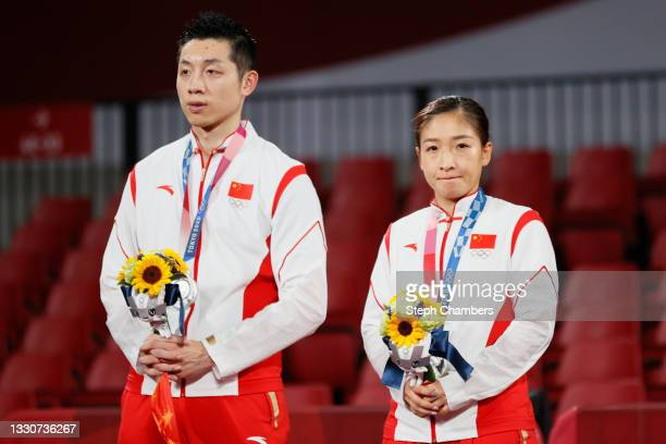 Xu Xin and Liu Shiwen of Team China on the podium during the Mixed Doubles medal ceremony on day three of the Tokyo 2020 Olympic Games at Tokyo...