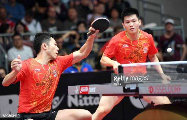 Xu Xin of China and Fan Zhendong of China compete during Men's Doubles first round match on day 2 of 2017 World Table Tennis Championships at Messe...