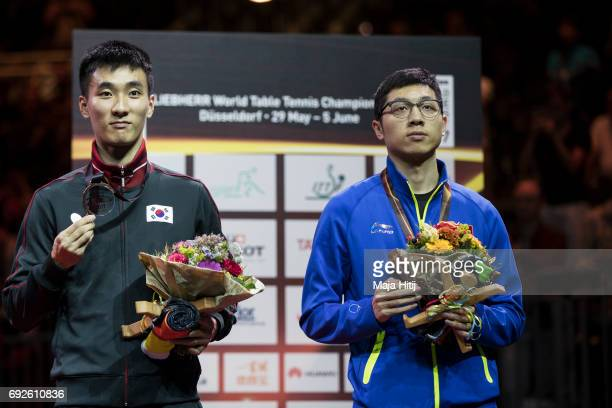 Xu Xin of China and Sangsu Lee of South Korea celebrate with a bronze medal during celebration ceremony of Men's Singles Final at Table Tennis World...