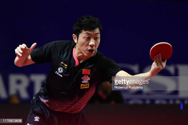Xu Xin of China competes against Lee Sangsu of South Korea during Men's Singles quarter-finals match on day six of the ITTF-Asian Table Tennis...
