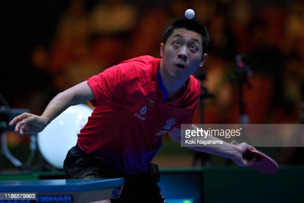 Xu Xin of China competes against Maharu Yoshimura of Japan during Men's Teams - Semifinals singles - Match 1 on day four of the ITTF Team World Cup,...
