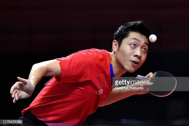 Xu Xin of China competes against of Harimoto Tomokazu Japan during Men's Team Champion Division semi-final match on day four of the ITTF-Asian Table...