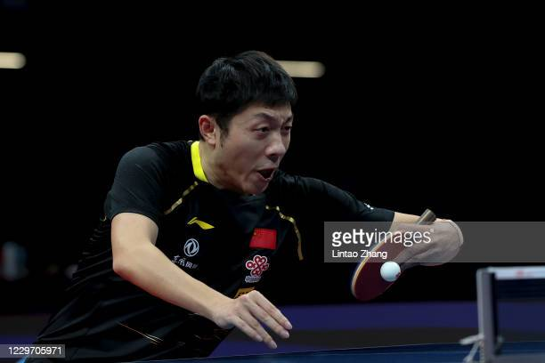 Xu Xin of China competes match against Ma Long of China in the Men's Singles - Semifinals during day three of 2020 ITTF Finals at Zhengzhou Olympic...