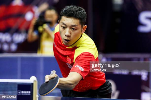 Xu Xin of China in action at the men's doubles match compete with Chen ChienAn and Chuang ChihYuan of Chinese Taipei during the 2018 ITTF World Tour...