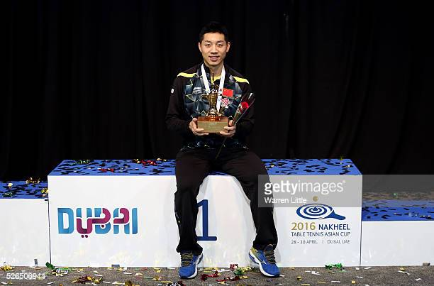 Xu Xin of China poses with the trophy after winning the Men's singles final of the Nakheel Table Tennis Asian Cup 2016 at Dubai World Trade Centre on...