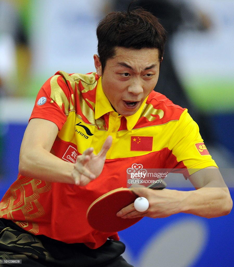 Xu Xin of China returns a service to Pavel Platonov of Belarus during the men's quarter final at the 2010 World Team Table Tennis Championships in Moscow on May 28, 2010.