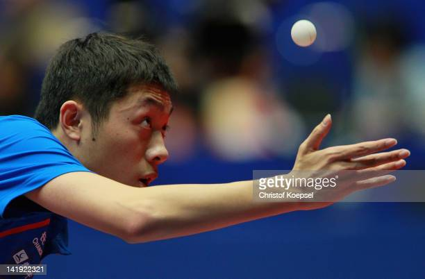 Xu Xin of China serves during his match against Nam Xu Xin of Korea DPR during the LIEBHERR table tennis team world cup 2012 championship division...