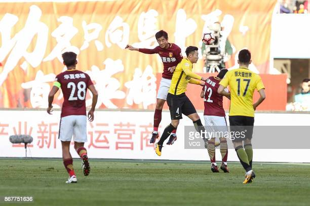 Xu Xin of Guangzhou Evergrande and Luo Senwen of Hebei China Fortune compete for ball during the Chinese Super League match between Hebei China...