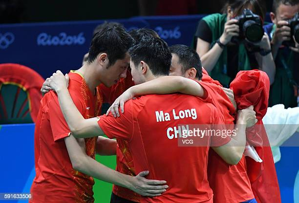 Xu Xin Zhang Jike coach Liu Guoliang and Ma Long of China celebrate after beating Japanese team during the Men's Table Tennis gold medal match on Day...