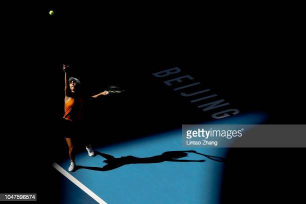 Xu Yifan of China hits a return with Gabriela Dabrowski of Canada against Andrea Sestini Hlavackova and Barbora Strycova of Czech Republic during...
