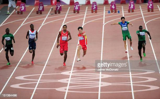 Xu Zhao of China leads the field as Yohansson Nascimento pulls up injured in the Men's 100m - T46 Final on day 8 of the London 2012 Paralympic Games...