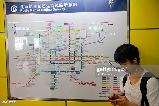 Xuanwumen Subway Station Asian man waiting on the Line 4 platform