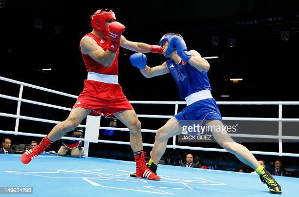 Xuanxuan Wang of China exchanges blows with Tervel Pulev of Bulgaria during their round of 16 Heavyweight boxing match of the London 2012 Olympics at...