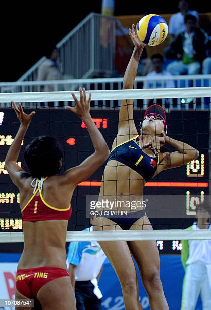 Xue Chen of China spikes a shot pass compatriot Huang Ying during the beach volleyball women's final match at the 16th Asian Games in Guangzhou on...