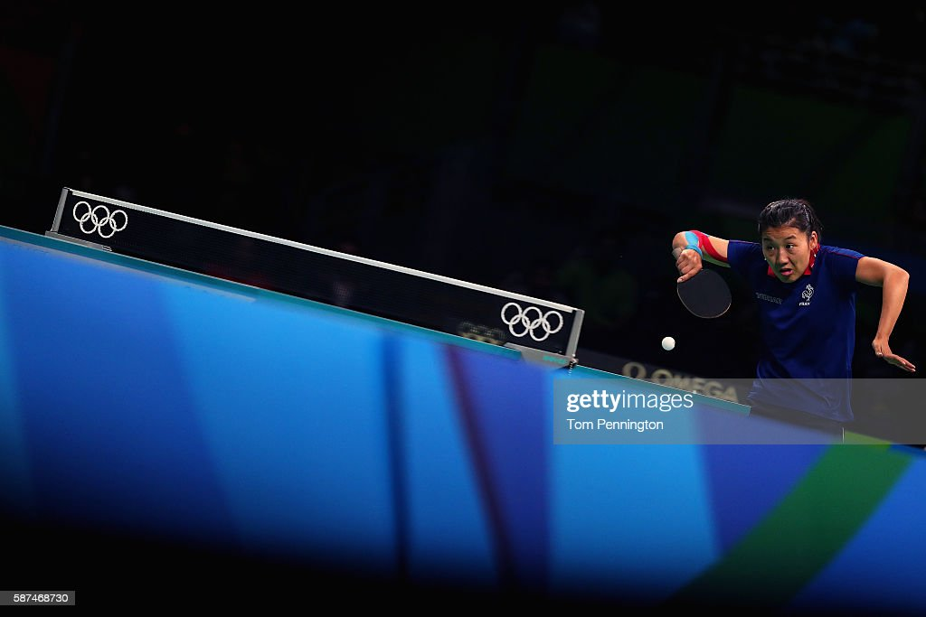 Xue Li of France competes against Ying Han of Germany during Round 4 of the Women's Singles Table Tennis on Day 3 of the Rio 2016 Olympic Games at Riocentro - Pavilion 3 on August 8, 2016 in Rio de Janeiro, Brazil.