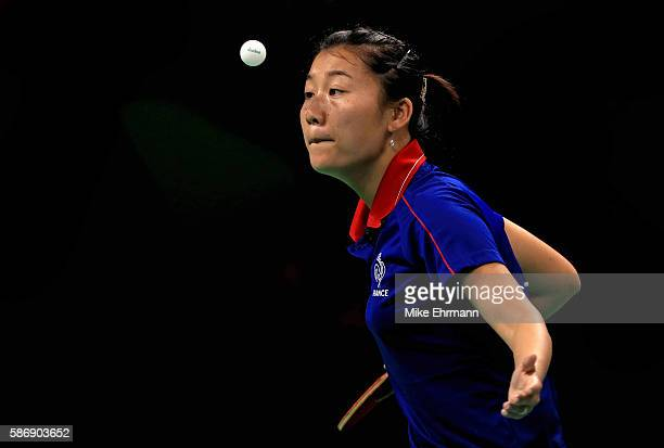 Xue Li of France plays a Women's Singles second round match against Adriana Diaz of Puerto Rico on Day 2 of the Rio 2016 Olympic Games at Riocentro...