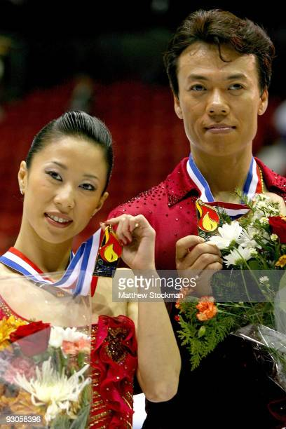 Xue Shen and Hongbo Zhao of China pose for photographers after winning the Pairs competition during the CancerNet Skate America at Herb Brooks Arena...
