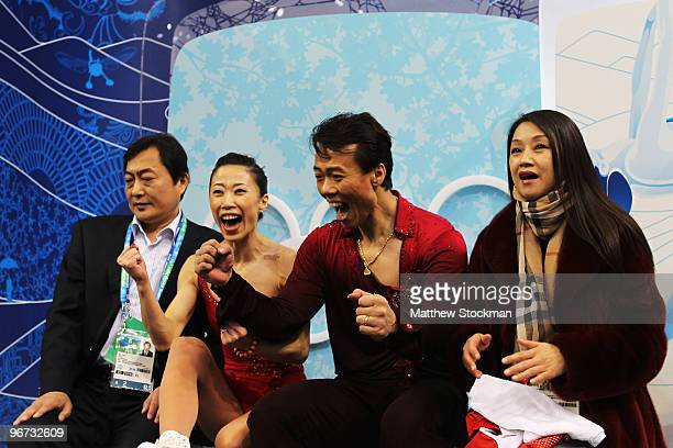 Xue Shen and Hongbo Zhao of China react in the kiss and cry area after they competed in the figure skating pairs free skating on day 4 of the...