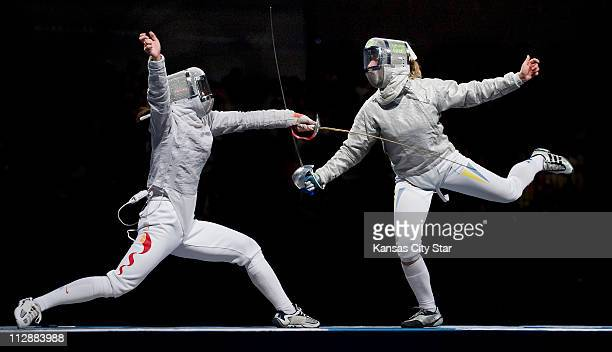 Xue Tan of China left and Olga Kharlan of the Ukraine duel in the gold medal match of the women's team sabre on Thursday August 14 in the Games of...