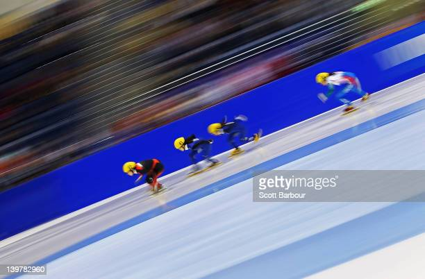 Xue Wang of China and Se Jung Ahn of Korea compete in the Ladies 500 Metres Semi Final on day two of the 2012 ISU Short Track Speed Skating Junior...