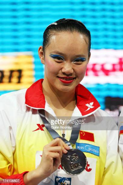 Xuechen Huang of China poses with her silver medal after the Synchronized Swimming Solo Technical final on day one of the 15th FINA World...