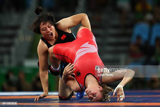 Xuechun Zhong of China competes against Yuliia Khavaldzhy Blahinya of Ukraine during the Women's Freestyle 53 kg Repechage Round 1 match on Day 13 of...